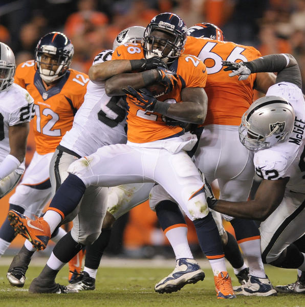 Denver Broncos running back Montee Ball (28) is tackled by Oakland Raiders outside linebacker Kaluka Maiava (50) in the fourth quarter of an NFL football game, Monday, Sept. 23, 2013, in Denver. (AP Photo/Jack Dempsey)