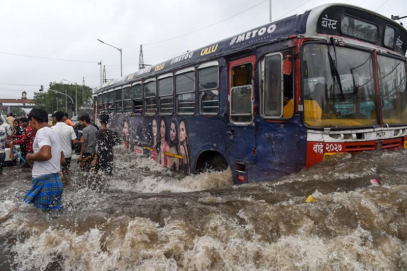 A public bus makes its way on a flooded road after heavy monsoon rains in Mumbai in August: Getty