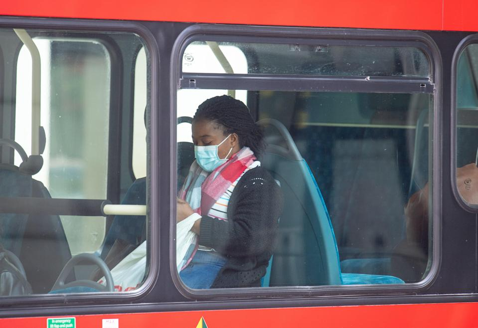 Face coverings on public transport were made mandatory in June 2020 (PA Archive)
