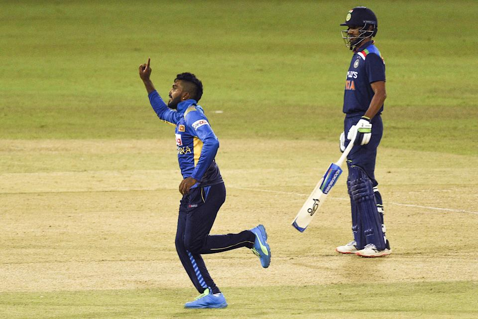 Sri Lanka's Wanindu Hasaranga (L) celebrates after the dismissalIndia's Prithvi Shaw (not pictured) as India's captain Shikhar Dhawan looks on during the second one-day international (ODI) cricket match between Sri Lanka and India at the R.Premadasa Stadium in Colombo on July 20, 2021. (Photo by Ishara S. KODIKARA / AFP) (Photo by ISHARA S. KODIKARA/AFP via Getty Images)