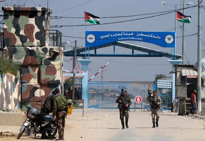 Hamas security forces stand guard at the Erez border crossing between Gaza and Israel