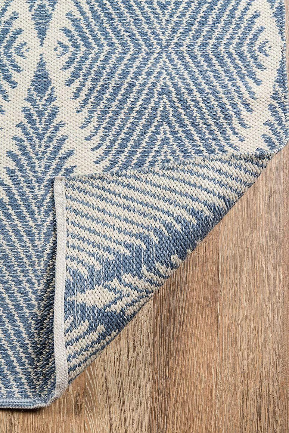 """<h2>Rugs</h2><br><h3>Erin Gates By Momeni River Beacon Indoor-Outdoor Rug </h3><br>Your flooring takes up the most surface area in your home. If your apartment comes with less-than-ideal floors, owning a unique and durable area rug is crucial for styling things up — like this indoor-outdoor style from Erin Gates by Momeni with its artfully handwoven blue hues.<br><br><em>Shop</em> <a href=""""https://amzn.to/2Y8PpdI"""" rel=""""nofollow noopener"""" target=""""_blank"""" data-ylk=""""slk:Amazon"""" class=""""link rapid-noclick-resp""""><strong><em>Amazon</em></strong></a><br><br><strong>Erin Gates by Momeni</strong> River Beacon Denim Indoor-Outdoor Rug (5' X 7'6""""), $, available at <a href=""""https://amzn.to/3A5q9m2"""" rel=""""nofollow noopener"""" target=""""_blank"""" data-ylk=""""slk:Amazon"""" class=""""link rapid-noclick-resp"""">Amazon</a>"""
