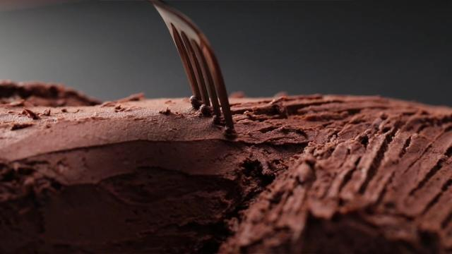 Creating bark texture on log cake with fork