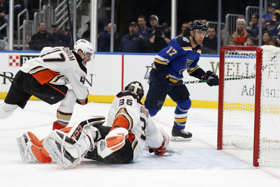 St. Louis Blues' Jaden Schwartz (17) scores past Anaheim Ducks goaltender John Gibson (36) and Hampus Lindholm (47) during the second period of an NHL hockey game Monday, Jan. 13, 2020, in St. Louis. (AP Photo/Jeff Roberson)