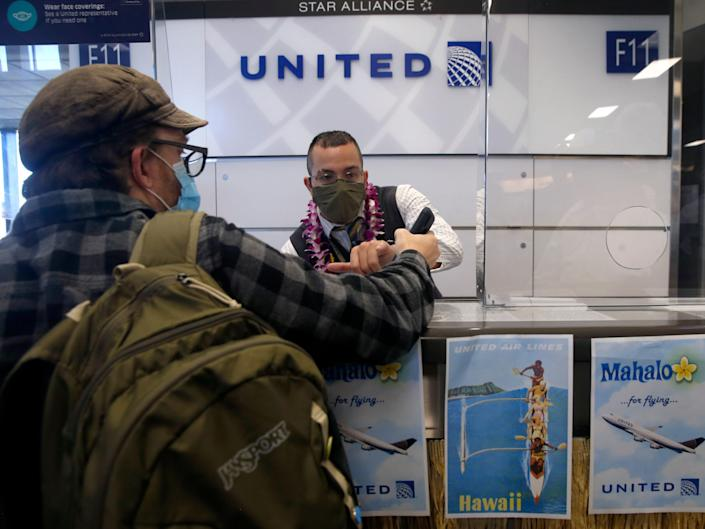 united airlines gate attendant helps passenger