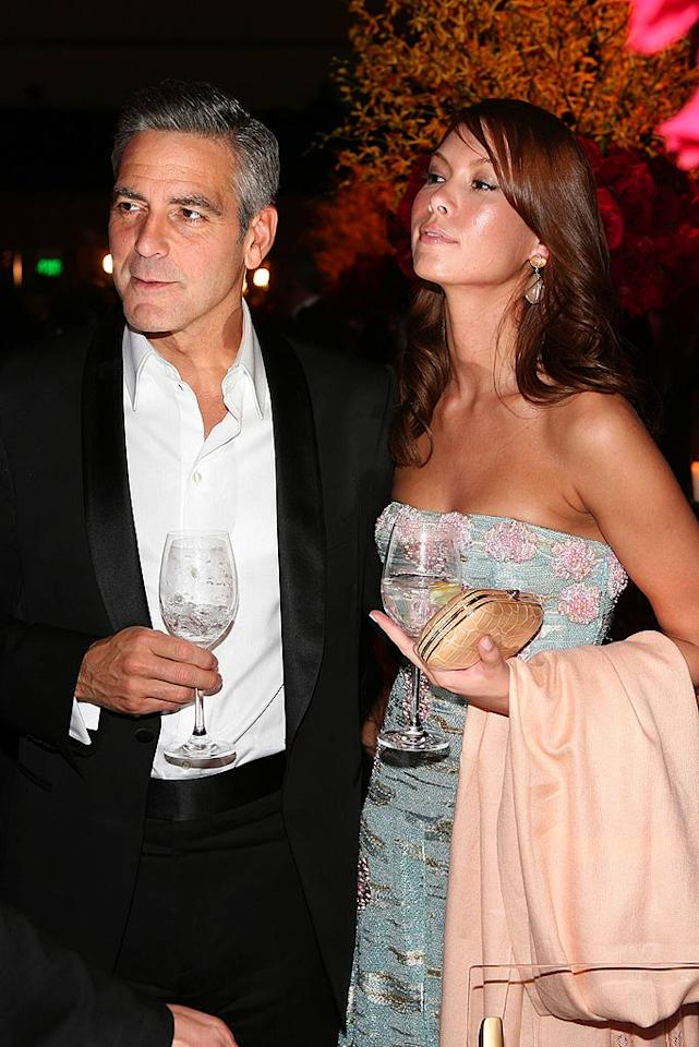 """All eyes were on George Clooney and his girlfriend Sarah Larson. Which of the two made the best eye candy? Frazer Harrison/<a href=""""http://www.gettyimages.com/"""" target=""""new"""">GettyImages.com</a> - February 24, 2008"""