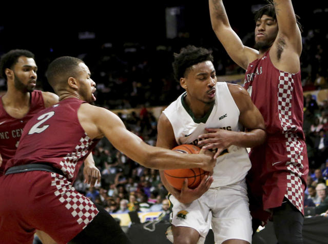 North Carolina Central's Jibri Blount, left, strips the ball from Norfolk State's Alex Long during an NCAA college basketball game in the championship of the Mid-Eastern Athletic Conference tournament, Saturday, March 16, 2019, in Norfolk, Va. (AP Photo/Jason Hirschfeld)