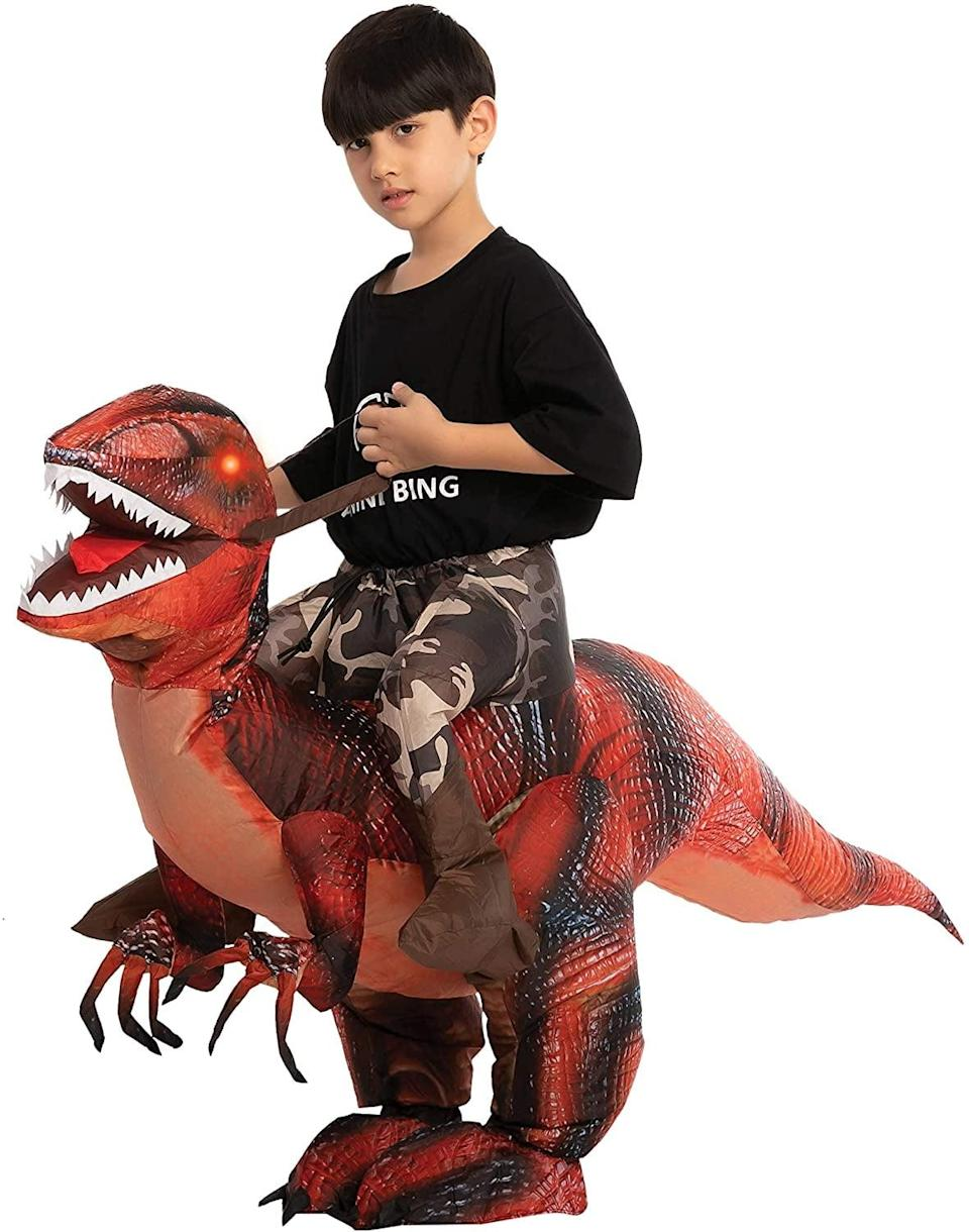 <p>Complete with LED lights for eyes, the <span>Spooktacular Creations Inflatable Ride A Raptor Halloween Costume</span> ($30) looks like it bites!</p>