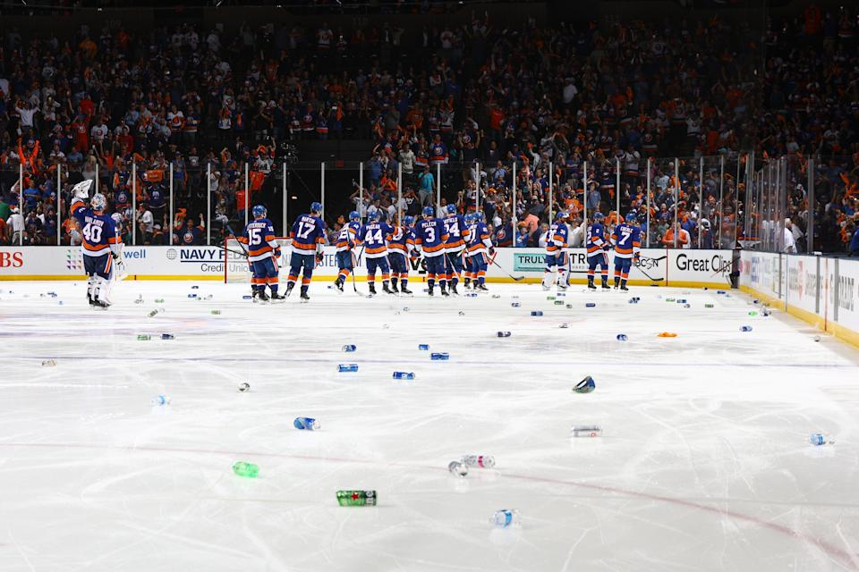 UNIONDALE, NEW YORK - JUNE 23:  The New York Islanders celebrate after a game winning goal in overtime by Anthony Beauvillier #18 to force a Game 7 against the Tampa Bay Lightning in Game Six of the Stanley Cup Semifinals of the 2021 Stanley Cup Playoffs at Nassau Coliseum on June 23, 2021 in Uniondale, New York. (Photo by Mike Stobe/NHLI via Getty Images)