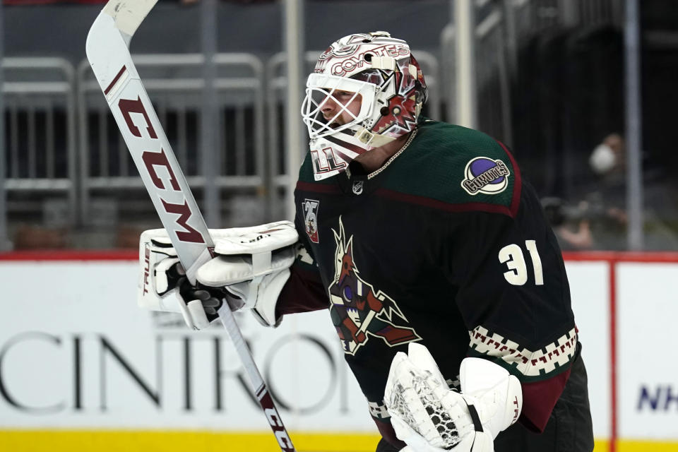 Arizona Coyotes goaltender Adin Hill reacts after the Coyotes defeated the Colorado Avalanche in a shootout in an NHL hockey game Tuesday, March 23, 2021, in Glendale, Ariz. (AP Photo/Rick Scuteri)