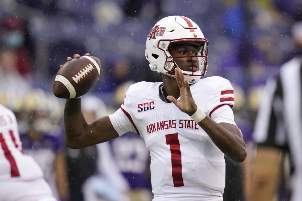 Arkansas State quarterback James Blackman passes against Washington in the first half of an NCAA college football game, Saturday, Sept. 18, 2021, in Seattle. (AP Photo/Elaine Thompson)