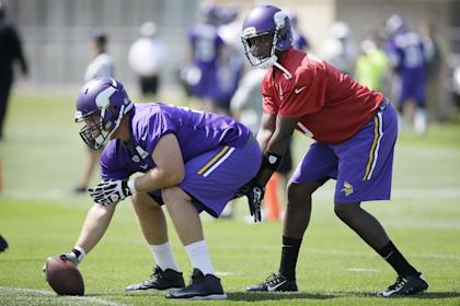 Teddy Bridgewater taking snaps in camp, plotting the takeover. (AP Photo/Charlie Neibergall)