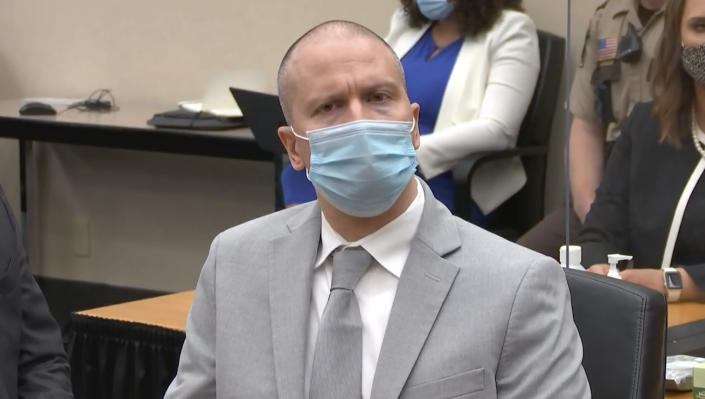 In this image taken from video, former Minneapolis police Officer Derek Chauvin listens as Hennepin County Judge Peter Cahill sentences him to 22 1/2 years in prison, Friday, June 25, 2021, for the May 25, 2020, death of George Floyd, at the Hennepin County Courthouse in Minneapolis. (Court TV via AP, Pool)