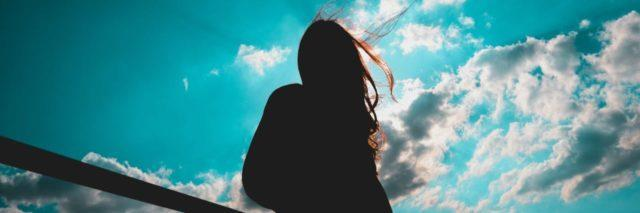 silhouette of woman looking at sky