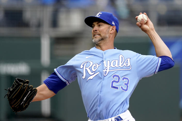 Kansas City Royals starting pitcher Mike Minor throws during the first inning in the first baseball game of a doubleheader against the Toronto Blue Jays, Saturday, April 17, 2021, in Kansas City, Mo. (AP Photo/Charlie Riedel)