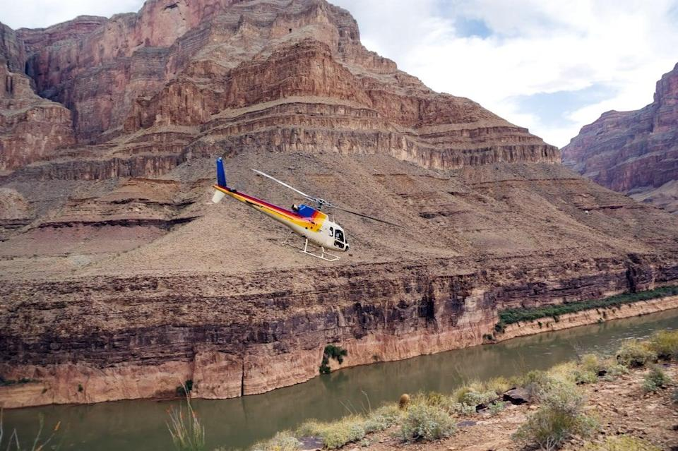Chopper flying over the Grand Canyon (Getty Images/iStockphoto)