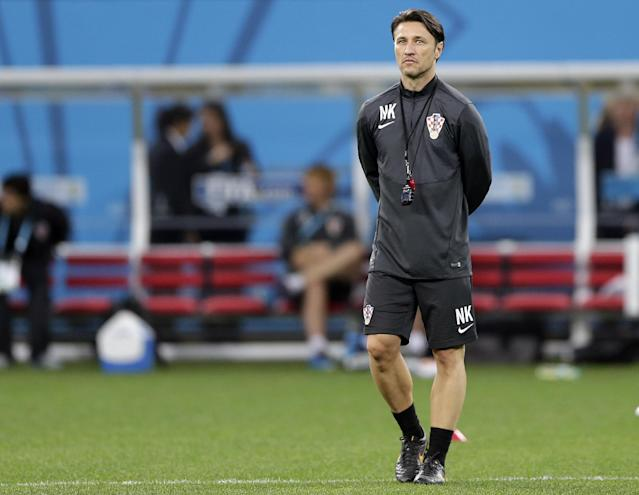 Croatia's coach Niko Kovac walks on the pitch during an official training session the day before the group A World Cup soccer match between Brazil and Croatia in the Itaquerao Stadium Sao Paulo , Brazil, Wednesday, June 11, 2014. (AP Photo/Andre Penner)