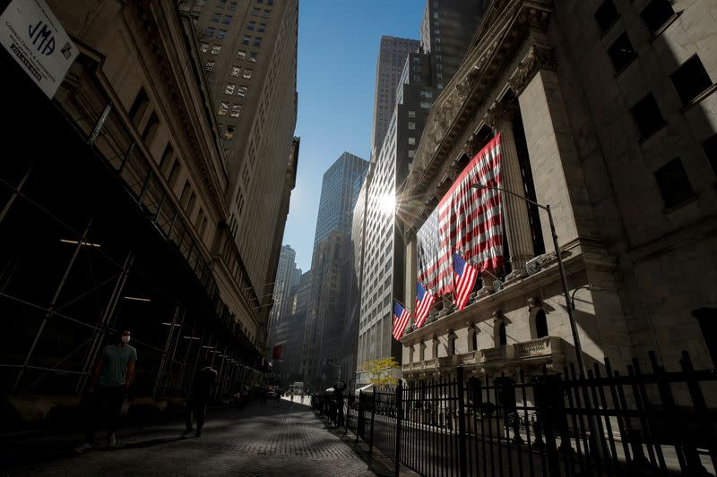The U.S. flag covers the front facade of the NYSE in New York