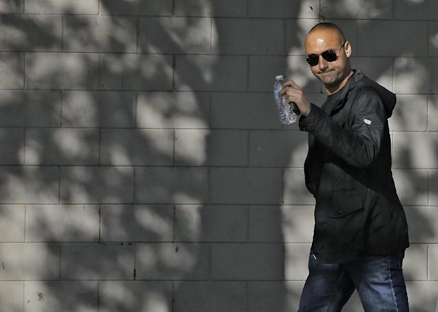 New York Yankees shortstop Derek Jeter waves as he arrives to workout at the baseball team's minor league facility Thursday, Feb. 13, 2014, in Tampa, Fla. Jeter announced that he is retiring at the end of the 2014 season. (AP Photo/Chris O'Meara)
