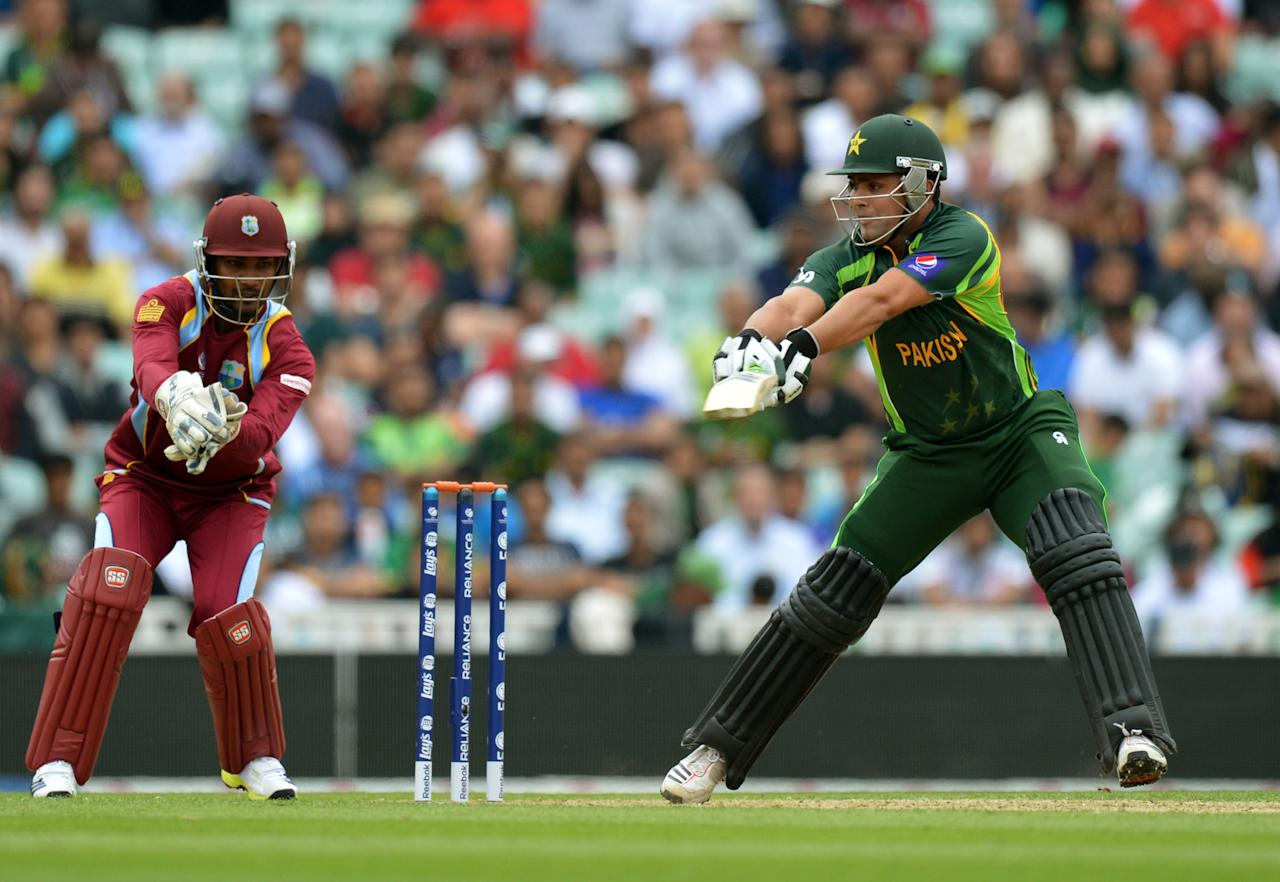 Pakistan's Kamran Akmal is caught behind by the West Indies' Denesh Ramdin during the ICC Champions Trophy match at The Oval, London.