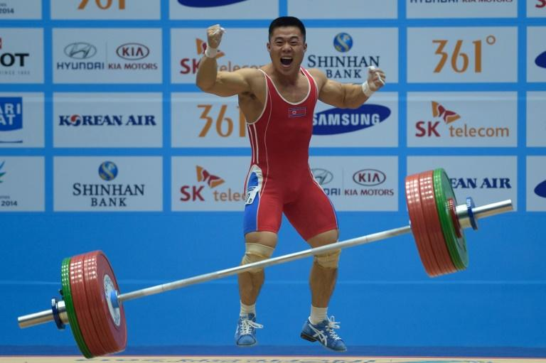 Disgraced: North Korea's Kim Un-Guk celebrates winning the men's 62kg in Incheon four years ago but is currenty servng a doping ban