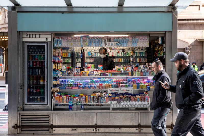 FILE PHOTO: A man wearing a protective mask is seen at a newsstand following the outbreak of coronavirus disease (COVID-19) in New York City