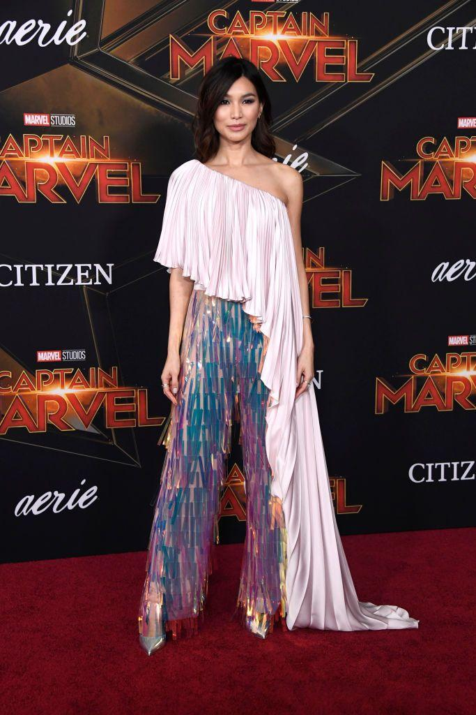 """<p>The Ladies of Marvel were out in force for the premiere of the<a href=""""https://www.elle.com/uk/life-and-culture/culture/news/a41250/brie-larson-captain-marvel-costume/"""" rel=""""nofollow noopener"""" target=""""_blank"""" data-ylk=""""slk:Brie Larson"""" class=""""link rapid-noclick-resp""""> Brie Larson</a> led Captain Marvel film last year with Chan wearing an iridescent twinset, courtesy of Ralph & Russo. Her one-shoulder floor-sweeping silk top and trousers is otherworldly.</p>"""
