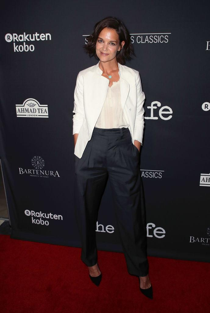 <p>For the Los Angeles premiere of 'The Wife' on 23 July, Katie Holmes wore a sharp white blazer and tapered trousers. <em>[Photo: Getty]</em> </p>