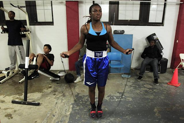 In this Sept. 18, 2012, photo, Olympic gold medal boxer Claressa Shields skips rope at the Berston Field House in Flint, Mich. Shields is a fearsome presence in the ring. Her scowl and angry stare are the first signs of the trouble that awaits her opponents. (AP Photo/Carlos Osorio)