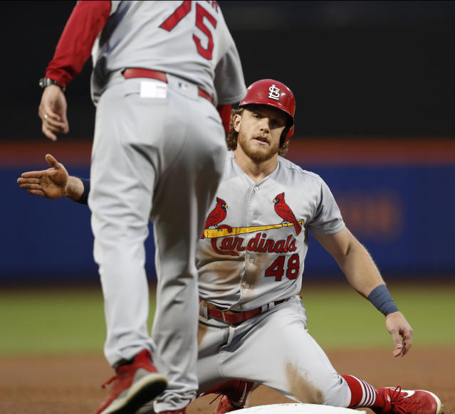 St. Louis Cardinals' third base coach Ron Warner congratulates Harrison Bader (48) after he stole third base during the third inning of a baseball game against the New York Mets, Thursday, June 13, 2019, in New York. (AP Photo/Kathy Willens)