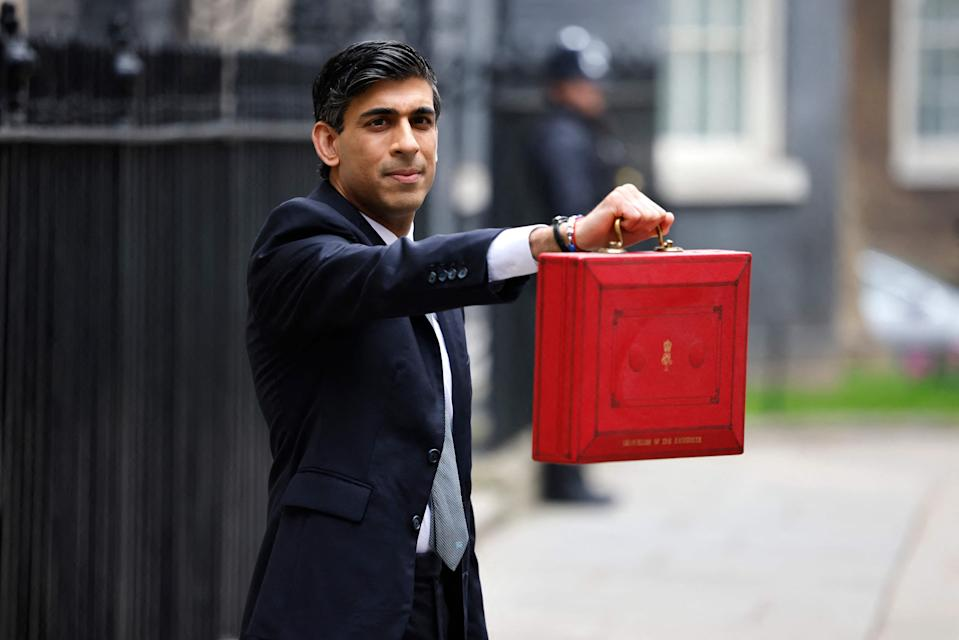 Rishi Sunak poses with the Budget BoxAFP via Getty Images