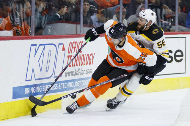 Philadelphia Flyers' James van Riemsdyk, left, and Boston Bruins' Josiah Didier chase the puck during the second period of a preseason NHL hockey game Thursday, Sept. 19, 2019, in Philadelphia. (AP Photo/Matt Slocum)