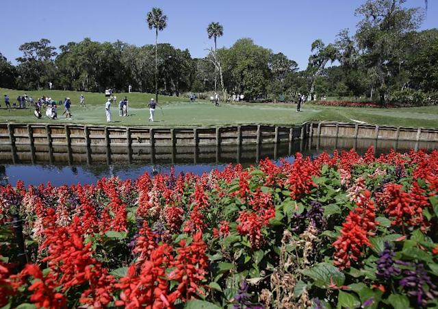 Players work on their putting on the 13th green during a practice round for The Players championship golf tournament at TPC Sawgrass in Ponte Vedra Beach, Fla., Wednesday, May 7, 2014. (AP Photo/John Raoux)
