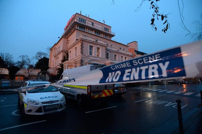 Masked men with AK-47s stormed a boxing event at the Regency Airport Hotel in Dublin on February 5, 2016, shooting one man dead (AFP Photo/Caroline Quinn)