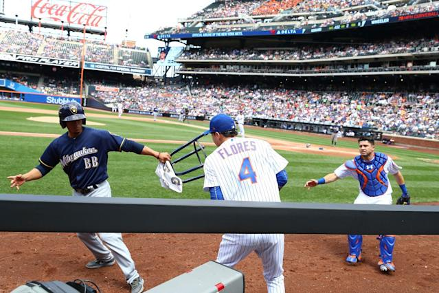 Wilmer Flores has a run-in with the Brewers' ball boy. (Getty Images)