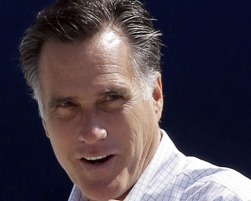 FILE - In this Sept. 23, 2012 file photo, Republican presidential candidate, former Massachusetts Gov. Mitt Romney gets ready to board his campaign plane in Los Angeles. Both presidential campaigns are trying to take advantage of an unusual Iowa law that gives their supporters a major say in determining where ballots can be cast before the election.  Iowa's law allows anyone who gets the signatures of 100 county voters to choose a specific voting place in that county. Before early voting begins Thursday, volunteers for both campaigns turned in a batch of petitions last week calling for voting at locations most convenient to their voters. (AP Photo/Charles Dharapak, File)