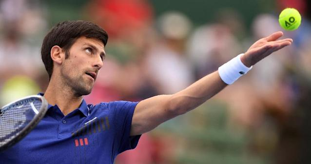Novak Djokovic made a winning return on January 10 after six months out with an elbow injury, declaring he felt 'great' after beating world number five Dominic Thiem 6-1, 6-4 at the Kooyong Classic (AFP Photo/WILLIAM WEST)