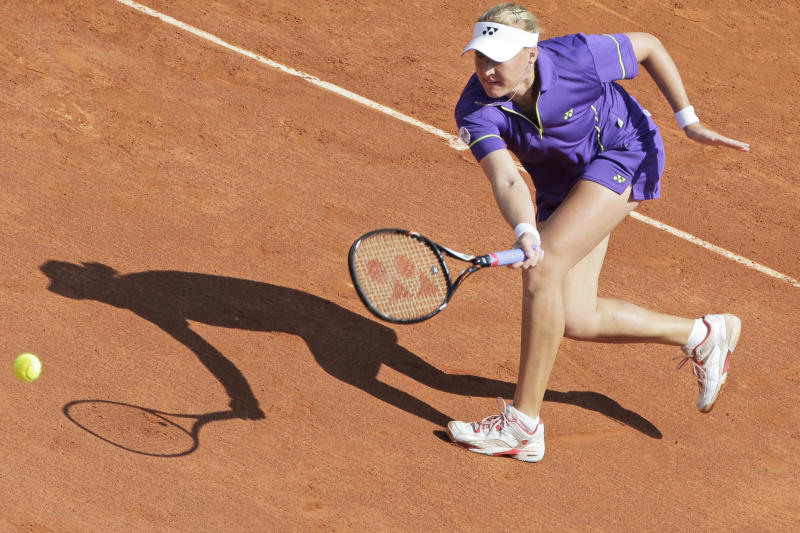 Britain's Elena Baltacha returns in her first round match against Samantha Stosur of Australia at the French Open tennis tournament in Roland Garros stadium in Paris, Sunday May 27, 2012. (AP Photo/Bernat Armangue)