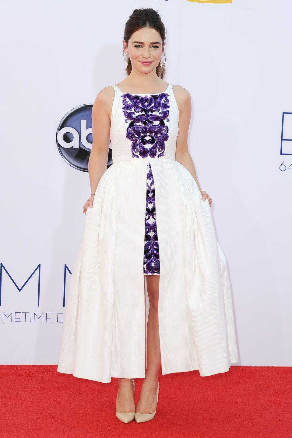 <p>Clarke (AKA Khaleesi) walked the Emmy Awards red carpet in this purple and white dress in 2012. </p>