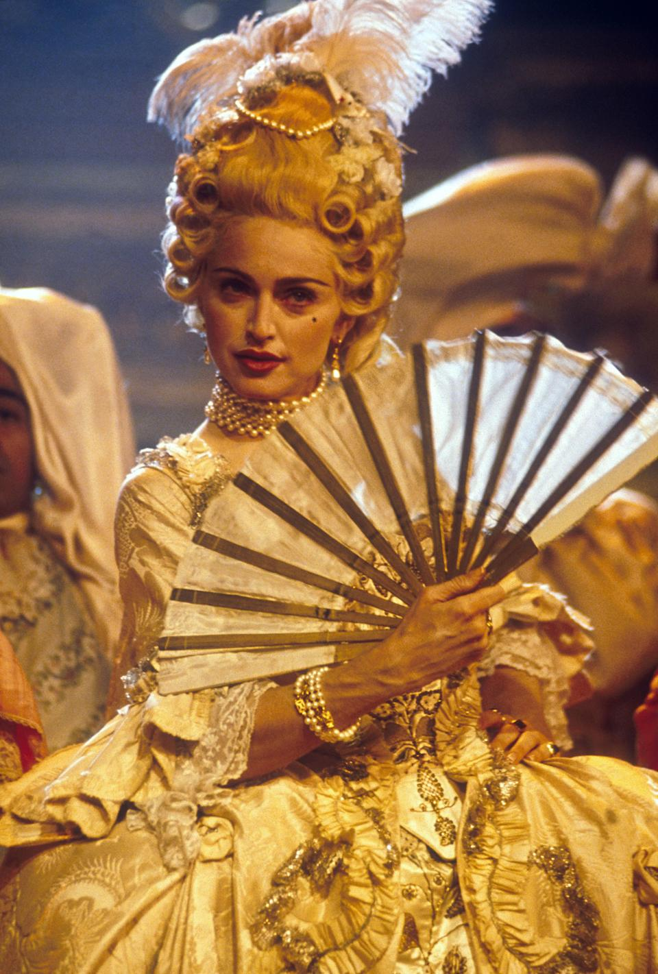 American singer and actress Madonna dressed in a Victorian gown performing her song 'Vogue,' on the MTV Video Music Awards in September 1990.