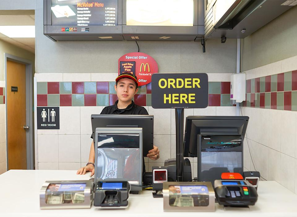 mcdonalds cash register and employee