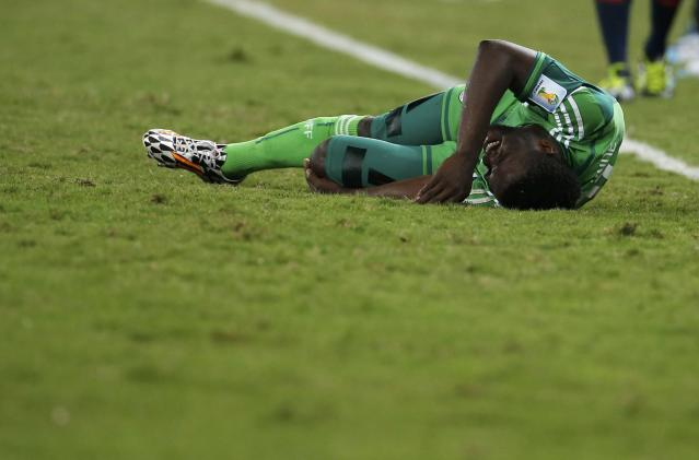 Nigeria's Michael Babatunde grimaces after being fouled by Bosnia's Mensur Mujdza (unseen) during their 2014 World Cup Group F soccer match at the Pantanal arena in Cuiaba June 21, 2014. REUTERS/Eric Gaillard (BRAZIL - Tags: SOCCER SPORT WORLD CUP TPX IMAGES OF THE DAY)