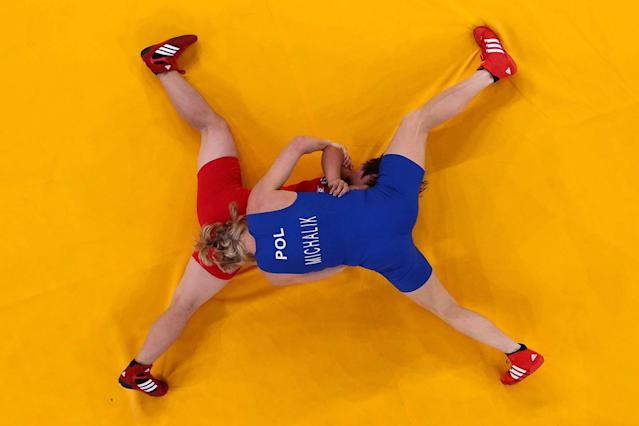 LONDON, ENGLAND - AUGUST 08: Mi Gyong Choe (red) of DPR Korea competes against Monika Ewa Michalik of Poland during their Women's Freestyle 63 kg Wrestling match on Day 12 of the London 2012 Olympic Games at ExCeL on August 8, 2012 in London, England. (Photo by Chris McGrath/Getty Images)