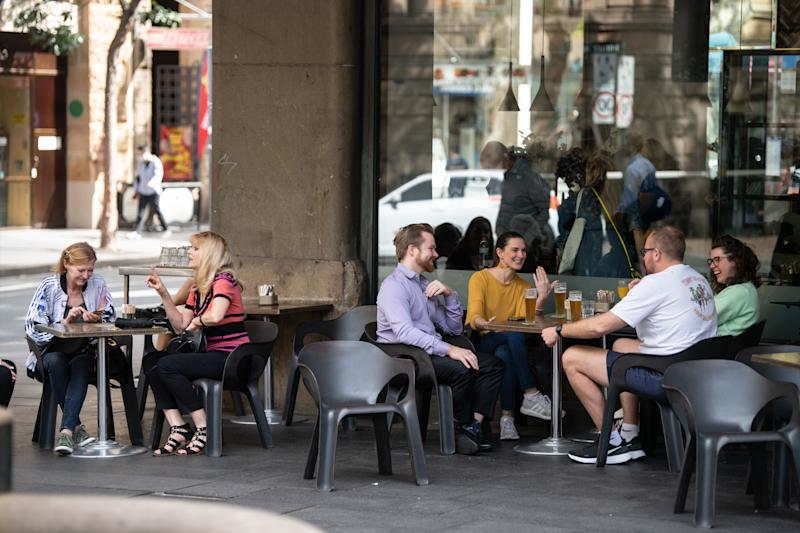 People outside a licensed venue before Mr Morrison's new restrictions came into effect on Monday. Source: AAP