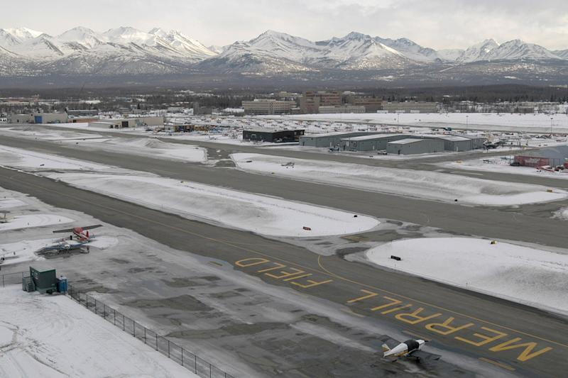 A small plane (center) takes to the air from Merrill Field Wednesday, March 9, 2005 in Anchorage, Alaska. With roughly 200,000 take-offs and landings a year, Merrill Field remains one of the nation's busiest airports.