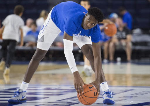 Duke Blue Devils' R.J. Barrett stretches during the warm-up prior to exhibition basketball action against McGill Redmen in Laval, Quebec, Sunday, Aug. 19, 2018. (Graham Hughes/The Canadian Press via AP)
