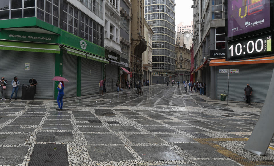 View of closed stores and empty streets after non-essential services were shut down at midnight and until March 20 in the state of Sao Paulo, amid the novel coronavirus COVID-19 pandemic, in Sao Paulo, Brazil, on March 6, 2021. - Brazil's biggest state, Sao Paulo, declared new