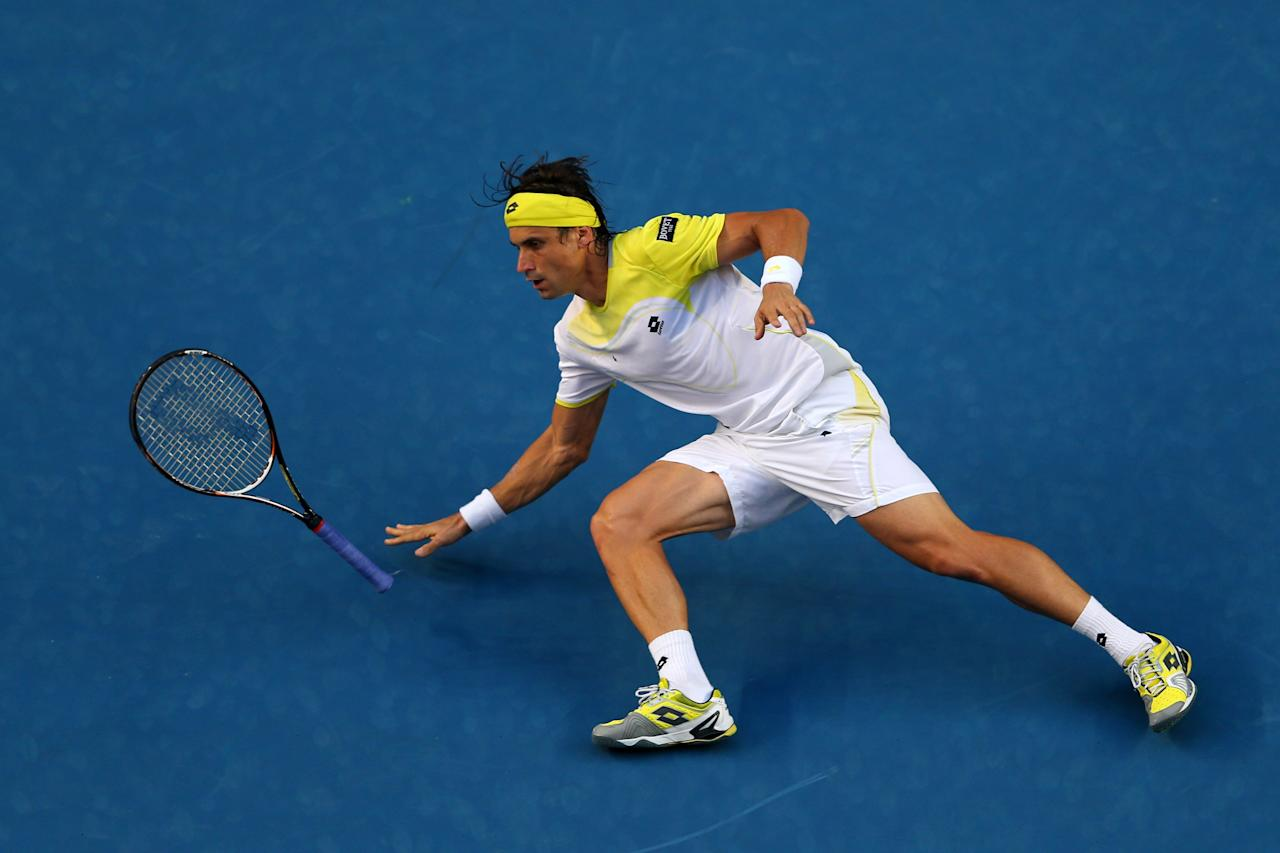 MELBOURNE, AUSTRALIA - JANUARY 14:  David Ferrer of Spain slides in his first round match against Olivier Rochus of Belgium during day one of the 2013 Australian Open at Melbourne Park on January 14, 2013 in Melbourne, Australia.  (Photo by Julian Finney/Getty Images)