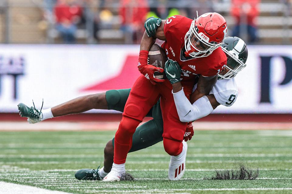 Oct 9, 2021; Piscataway, New Jersey, USA; Rutgers Scarlet Knights wide receiver Brandon Sanders (12) is tackled by Michigan State Spartans cornerback Marqui Lowery (9) during the second half at SHI Stadium.