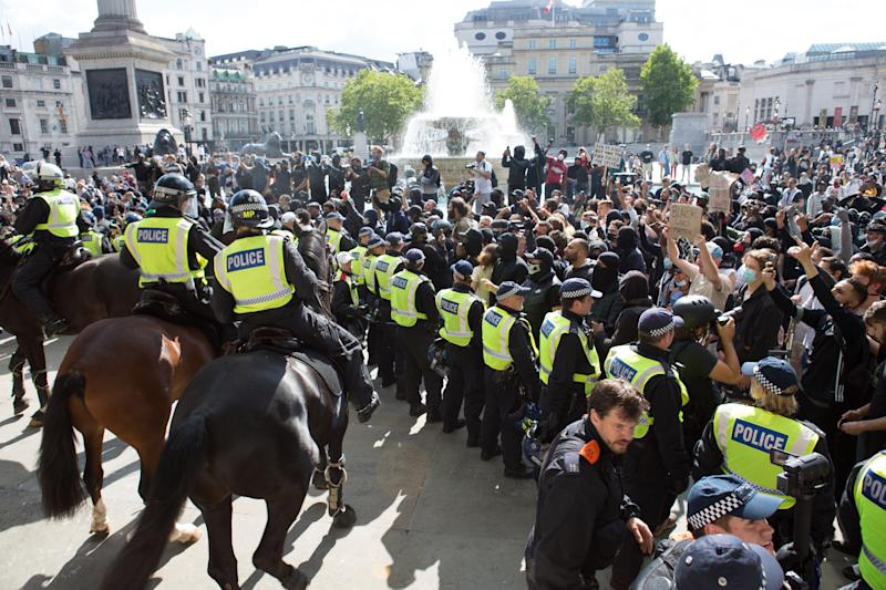 "Former Met Commissioner Police officers confront Black Lives Matter activists near the National Gallery during the demonstration. Groups including the far-right activists congregated in the capital, claiming they were protecting statues from anti-racism activists. Boris Johnson said ""racist thuggery has no place on our streets"" after officers were seen being punched and kicked. Some peaceful anti-racism protests also took place in London and across the UK. (Photo by Rahman Hassani / SOPA Images/Sipa USA)"